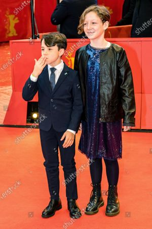 Stock Photo of Child actors Alida Baldari Calabria and Federico Ielapi arrive for the premiere of 'Pinocchio' during the 70th annual Berlin International Film Festival (Berlinale), in Berlin, Germany, 23 February 2020. The movie is presented in the Berlinale Special section at the Berlinale that runs from 20 February to 01 March 2020.