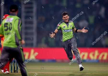 Lahore Qalandars pacer Shaheen Shah Afridi celebrates after taking the wicket of Islamabad United batsman Asif Ali during their Pakistan Super League T20 cricket match at Gaddafi stadium in Lahore, Pakistan