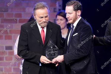 Stock Image of Marco Kreuzpaintner (R) and Franco Nero receive the Cinema for peace award during the Cinema for Peace gala during the 70th annual Berlin International Film Festival (Berlinale), in Berlin, Germany, 23 February 2020.