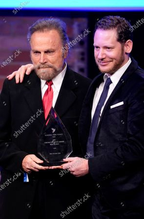 Marco Kreuzpaintner (R) and Franco Nero receive the Cinema for peace award during the Cinema for Peace gala during the 70th annual Berlin International Film Festival (Berlinale), in Berlin, Germany, 23 February 2020.