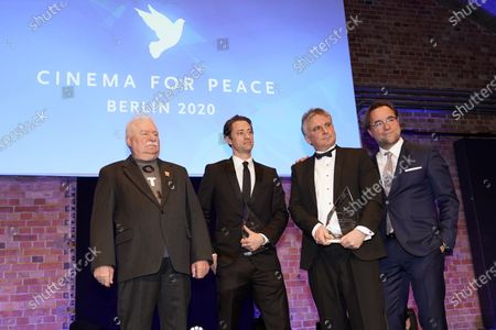 Lech Walesa (L), Daniel T. Jones(2-L), Jan Josef Liefers pose during the Cinema for Peace Gala during the 70th annual Berlin International Film Festival (Berlinale), in Berlin, Germany, 23 February 2020.
