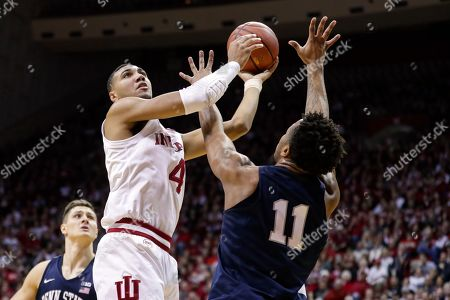 Indiana forward Trayce Jackson-Davis (4) grabs a rebounds and shoots over Penn State forward Lamar Stevens (11) in the first half of an NCAA college basketball game in Bloomington, Ind