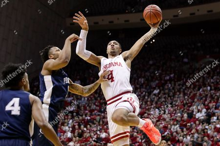 Indiana forward Trayce Jackson-Davis (4) shoots over Penn State forward Seth Lundy (1) in the first half of an NCAA college basketball game in Bloomington, Ind
