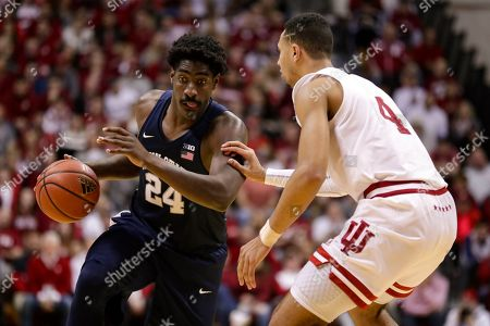 Penn State forward Mike Watkins (24) is defended by Indiana forward Trayce Jackson-Davis (4) as he drives the lane in the second half of an NCAA college basketball game in Bloomington, Ind., . Indiana defeated Penn State 68-60