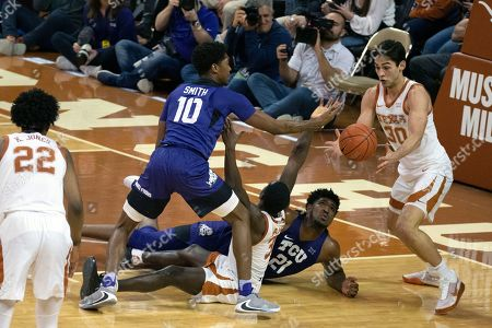 Brock Cunningham, Courtney Ramey, Kevin Samuel, Diante Smith. Texas' Brock Cunningham (30) and Courtney Ramey (3) fights for a loose ball with TCU's Kevin Samuel (21) and Diante Smith (10) during the second half of an NCAA college basketball game, Weds., in Austin, Texas. Texas won 70-56