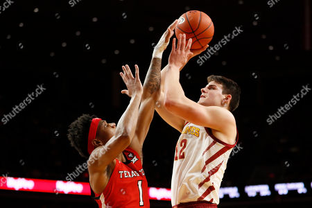 Iowa State forward Michael Jacobson shoots over Texas Tech guard Terrence Shannon Jr., left, during the first half of an NCAA college basketball game, in Ames, Iowa