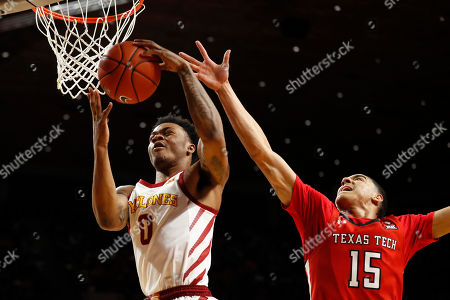 Iowa State forward Zion Griffin, left, fights for a rebound with Texas Tech guard Kevin McCullar, right, during the first half of an NCAA college basketball game, in Ames, Iowa