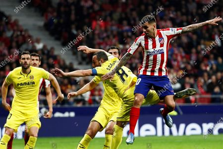 Atletico Madrid's Angel Correa (R) in action against Villarreal's Santi Cazorla (2-R) during the Spanish La Liga soccer match between Atletico Madrid and Villarreal CF at Metropolitano stadium in Madrid, Spain, 23 February 2020.