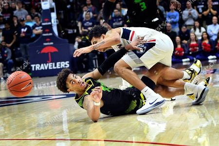 Connecticut's James Bouknight (2) and South Florida's David Collins (0) battle for the ball during the second half of an NCAA college basketball game, in Storrs, Conn