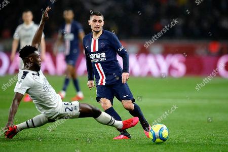 PSG's Mitchel Bakker, left, controls the ball by Bordeaux's Laurent Koscielny during the French League One soccer match between Paris-Saint-Germain and Bordeaux at the Parc des Princes stadium in Paris