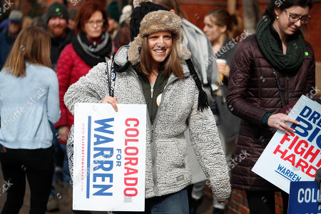 Stock Picture of R m. A supporter heads into a campaign rally for Democratic presidential candidate U.S. Sen. Elizabeth Warren, D-Mass., in Denver