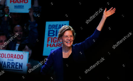 R m. Democratic presidential candidate Sen. Elizabeth Warren, D-Mass., waves as she takes the stage to speak at a campaign rally, in Denver