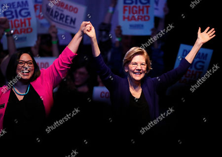 R m. Democratic presidential candidate Sen. Elizabeth Warren, D-Mass., right, acknowledges the crowd with Colorado State Sen. Julie Gonzalez, D-Denver, before speaking at a campaign rally, in Denver