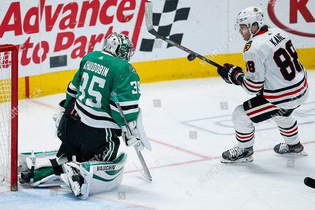Dallas Stars goaltender Anton Khudobin (35) blocks a shot from Chicago Blackhawks forward Patrick Kane (88) during the second period of an NHL hockey game, in Dallas