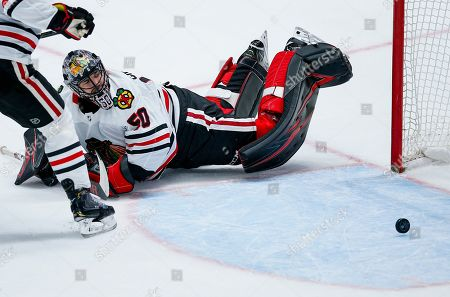 Chicago Blackhawks goaltender Corey Crawford (50) looks on after giving up a goal to Dallas Stars forward Tyler Seguin during the second period of an NHL hockey game, in Dallas