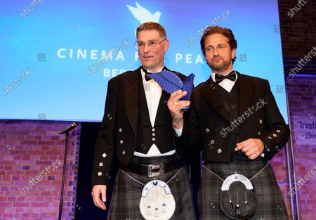 Gerard Butler (R) poses with Magnus MacFarlane Barrow (L), founder and CEO of Mary's Meals, after receiving an award for his work for the international charity organization Mary's Meals at the Cinema for Peace gala during the 70th annual Berlin International Film Festival (Berlinale), in Berlin, Germany, 23 February 2020. The Berlinale runs from 20 February to 01 March 2020.