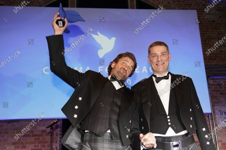 Gerard Butler (L) poses with Magnus MacFarlane Barrow (R), founder and CEO of Mary's Meals, after receiving an award for his work for the international charity organization Mary's Meals at the Cinema for Peace gala during the 70th annual Berlin International Film Festival (Berlinale), in Berlin, Germany, 23 February 2020. The Berlinale runs from 20 February to 01 March 2020.