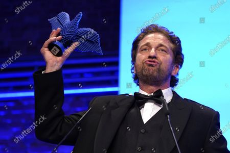 Gerard Butler speaks after receiving an award for his work for the international charity organization Mary's Meals at the Cinema for Peace gala during the 70th annual Berlin International Film Festival (Berlinale), in Berlin, Germany, 23 February 2020. The Berlinale runs from 20 February to 01 March 2020.
