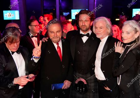 Gerard Butler (C) and Franco Nero (2-L) pose with guests at the Cinema for Peace Gala during the 70th annual Berlin International Film Festival (Berlinale), in Berlin, Germany, 23 February 2020. The Berlinale runs from 20 February to 01 March 2020.