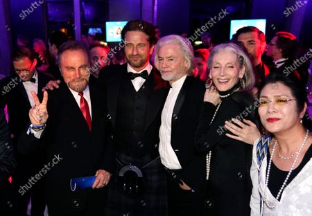 Gerard Butler (2-L) and Franco Nero (L) pose with guests at the Cinema for Peace Gala during the 70th annual Berlin International Film Festival (Berlinale), in Berlin, Germany, 23 February 2020. The Berlinale runs from 20 February to 01 March 2020.