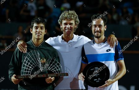 Stock Image of Winner Cristian Garin of Chile, left, poses for photos with second place finisher Gianluca Mager of Italy, right, and Brazilian former tennis player Gustavo Kuerten, center, at the end of the final match of the Rio Open tennis tournament in Rio de Janeiro, Brazil