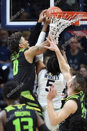 South Florida's David Collins (0) blocks a shot by Connecticut's Isaiah Whaley (5) during the second half of an NCAA college basketball game, in Storrs, Conn