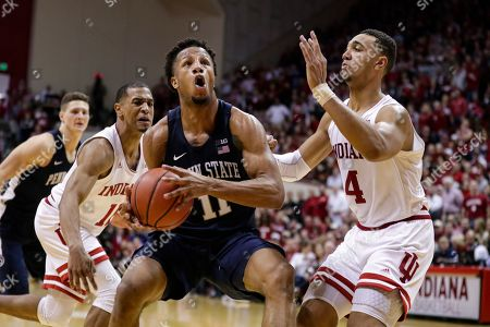Stock Picture of Penn State forward Lamar Stevens (11) cuts between Indiana forward Trayce Jackson-Davis (4) and guard Devonte Green (11) in the second half of an NCAA college basketball game in Bloomington, Ind., . Indiana defeated Penn State 68-60