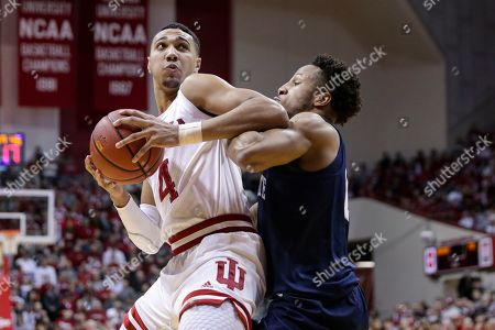 Indiana forward Trayce Jackson-Davis (4) drives on Penn State forward Lamar Stevens (11) in the first half of an NCAA college basketball game in Bloomington, Ind