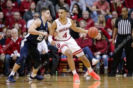 Stock Photo of Indiana forward Trayce Jackson-Davis (4) drives on Penn State forward John Harrar (21) in the second half of an NCAA college basketball game in Bloomington, Ind., . Indiana defeated Penn State 68-60