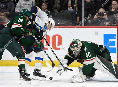 Stock Picture of Minnesota Wild's Jordan Greenway (18) and goaltender Devan Dubnyk (40) defend against a shot by St. Louis Blues' Alexander Steen (20) during the second period of an NHL hockey game, in St. Paul, Minn