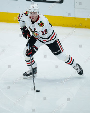 Chicago Blackhawks forward Jonathan Toews (19) skates with the puck during the second period of an NHL hockey game against the Dallas Stars, in Dallas. Dallas won 2-1