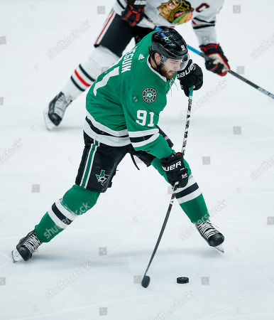 Dallas Stars forward Tyler Seguin (91) attempts a shot during the second period of an NHL hockey game against the Chicago Blackhawks, in Dallas. Dallas won 2-1