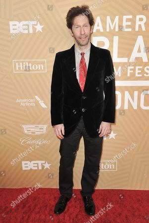 Stock Photo of Tim Blake Nelson attends the American Black Film Festival Honors Awards at the Beverly Hilton Hotel, in Beverly Hills, Calif