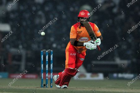 Asif Ali of Islamabad United plays a shot during Pakistan Super League (PSL) T20 series match, against Lahore Qalandars in Lahore, Pakistan, 23 February 2020 (issued 24 February 2020). (issued 24 February 2020).