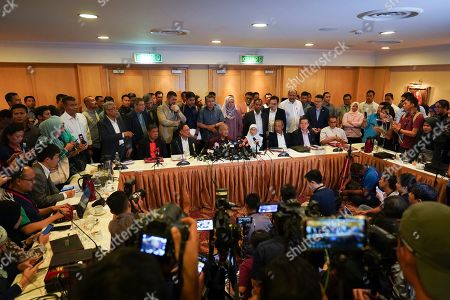 Malaysian Prime Minister Mahathir Mohamad, center right, speaks during a press conference in Putrajaya, Malaysia. Malaysia's alliance government under 94-year-old Prime Minister Mahathir is threatening to unravel less than two years after a historic election victory ousting the coalition that had ruled the country since independence