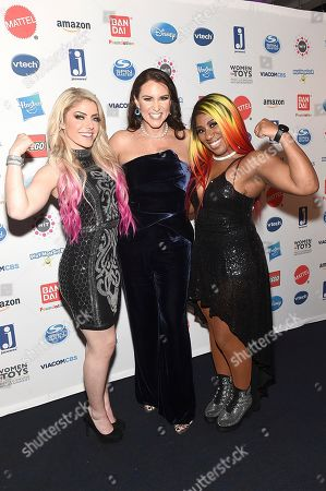 Alexa Bliss, Stephanie McMahon, Ember Moon. Wonder Women Award Honoree Stephanie McMahon, center, poses with WWE Superstars Alexa Bliss, left, and Ember Moon, right, at the 16th Annual Wonder Women Awards, presented by Women in Toys, Licensing and Entertainment (WIT), coinciding with Toy Fair New York