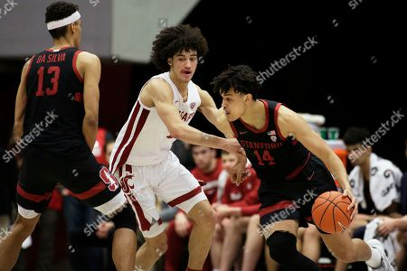 Stanford forward Spencer Jones, right, dribbles the ball while defended by Washington State forward CJ Elleby, center, who goes around a screen set by forward Oscar da Silva during the second half of an NCAA college basketball game in Pullman, Wash
