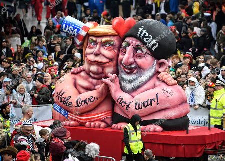 A carnival float depicts US President Donald Trump holding hands with Iran's President Hassan Rohani during the traditional carnival parade in Duesseldorf, Germany, on . The foolish street spectacles in the carnival centers of Duesseldorf, Mainz and Cologne, watched by hundreds of thousands of people, are the highlights in Germany's carnival season on Rosemonday