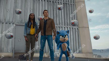Tika Sumpter as Maddie Wachowski, James Marsden as Tom Wachowski and Sonic (Ben Schwartz)