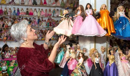 Spanish Charo Anguiano, 71, poses for the photographer with dozens of her more than 3,000 dolls, a collection that includes several antique dolls from the 19th century, in her native town of Logrono, La Rioja, northern Spain, 24 February 2020. Anguiano aims to create an exhibition titled 'El orfanato de munecas' (lit. The Doll Orphanage) to show her collection, as she looks forward to use some space provided by the regional Administration.