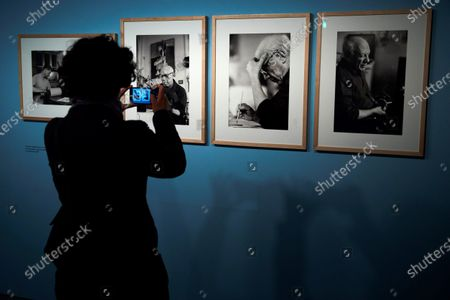 A woman takes smartphone photos of art pieces of the exhibition 'Picasso by Duncan. The knowing look' of 62 pictures taken by US photographer David Douglas Duncan between 1956 and 1962 that shows the private life and work progress of the Spanish painter. The exhibition runs from 22 February to 31 May 2020.
