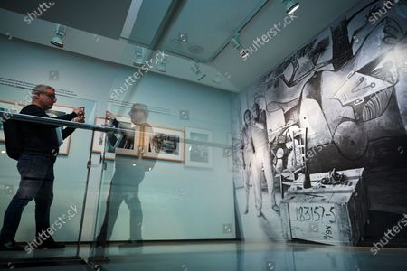 A man looks at art pieces of the exhibition 'Picasso by Duncan. The knowing look' of 62 pictures taken by US photographer David Douglas Duncan between 1956 and 1962 that shows the private life and work progress of the Spanish painter. The exhibition runs from 22 February to 31 May 2020.