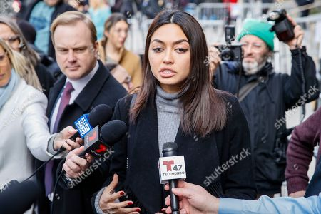 Ambra Battilana speaks to reporters outside of a Manhattan courthouse after Harvey Weinstein is convicted in his rape trial, in New York. A jury convicted Weinstein of rape and sexual assault. The jury found him not guilty of the most serious charge, predatory sexual assault, which could have resulted in a life sentence
