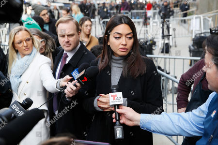 Ambra Battilana speaks to reporters outside of a Manhattan courthouse after Harvey Weinstein was convicted in his rape trial, in New York. A jury convicted Weinstein of rape and sexual assault. The jury found him not guilty of the most serious charge, predatory sexual assault, which could have resulted in a life sentence