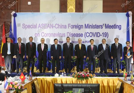 ASEAN Foreign Ministers (L-R) Malaysia's Foreign Minister Saifuddin Abdullah, Myanmar's Union Minister for International Cooperation U Kyaw Tin, Singapore's Foreign Minister Vivian Balakrishnan, Thailand's Minister of Foreign Affairs Don Pramudwinai, Vietnam's Foreign Minister Pham Binh Minh, China's Foreign Minister Wang Yi, Philippines Secretary of Foreign Affairs Teodoro Locsin, Laos Foreign Minister Saleumxay Kommasith, Brunei's Second Minister of Foreign Affairs and Trade Haji Erywan Yusof, Cambodia's Minister of Foreign Affairs Prak Sokhonn and Indonesia's Foreign Minister Retno Marsudi attend a the Special ASEAN-China Foreign Ministers' Meeting on Coronavirus Disease or Covid-19 in Vientiane, Laos, 20 February 2020. China's Foreign Minister Wang Yi attended an emergency meeting with his ASEAN counterparts to discuss the cooperation in containing the Covid-19 outbreak crisis.