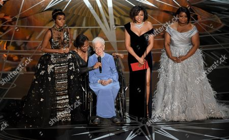 """Janelle Monae, Taraji P. Henson, Katherine Johnson, Octavia Spencer. Janelle Monae, left, Taraji P. Henson, second right and Octavia Spencer, right, introduce Katherine Johnson, seated, the inspiration for """"Hidden Figures,"""" as they present the award for best documentary feature at the Oscars at the Dolby Theatre in Los Angeles. Johnson, a mathematician on early space missions who was portrayed in film """"Hidden Figures,"""" about pioneering black female aerospace workers, died"""
