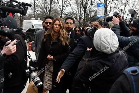 """Former """"Empire"""" actor Jussie Smollett, center, arrives for an initial court appearance, at the Leighton Criminal Courthouse in Chicago, on a new set of charges alleging that he lied to police about being targeted in a racist and homophobic attack in downtown Chicago early last year"""
