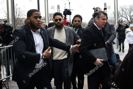Actor Jussie Smollett, third from left, arrives for a court appearance at the Leighton Criminal Courthouse in Chicago, on a new set of charges alleging that he lied to police about being targeted in a racist and homophobic attack in downtown Chicago early last year