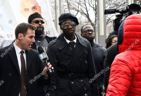 Brothers Olabinjo Osundairo, center, and Abimbola Osundairo, right, arrive at the Leighton Criminal Courthouse in Chicago on where actor Jussie Smollett made an appearance on a new set of charges alleging that he lied to police about being targeted in a racist and homophobic attack in downtown Chicago early last year. The brothers claim Smollett hired them to stage an attack on him