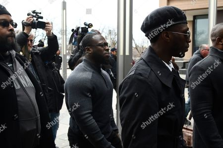 Brothers Olabinjo Osundairo, right, and Abimbola Osundairo, center, arrive at the Leighton Criminal Courthouse in Chicago on where actor Jussie Smollett made an appearance on a new set of charges alleging that he lied to police about being targeted in a racist and homophobic attack in downtown Chicago early last year. The brothers claim Smollett hired them to stage an attack on him